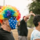 Ken Levi wears a mask and wig to the Gay Pride Mob Flash Dance in front of Mayor Ivy Taylors house.