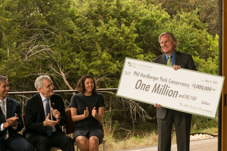 Phil Hardberger Park Conservancy member Doug McMurry delivers a check at the Urban Ecology Center at Phil Hardberger Park.