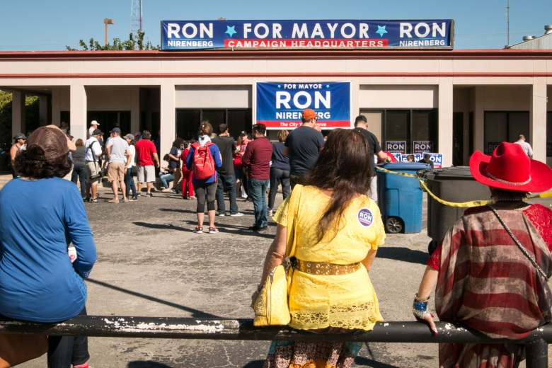 A large crowd gathers outside of Ron Nirenberg's campaign headquarters.