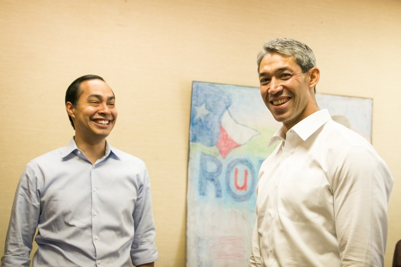 (From left) Former Mayor Julián Castro and Councilman Ron Nirenberg (D8) share a laugh at Nirenberg's campaign headquarters.