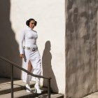 Nora Aceves, dressed as Princess Leia, descends a staircase in Main Plaza on May the Fourth.