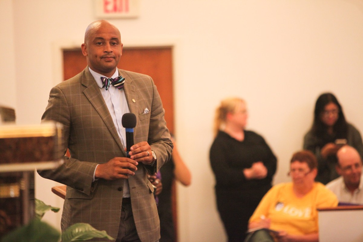 """Councilman Alan Warrick (D2) speaks at the COPS/Metro Alliance's """"get out the vote"""" rally."""