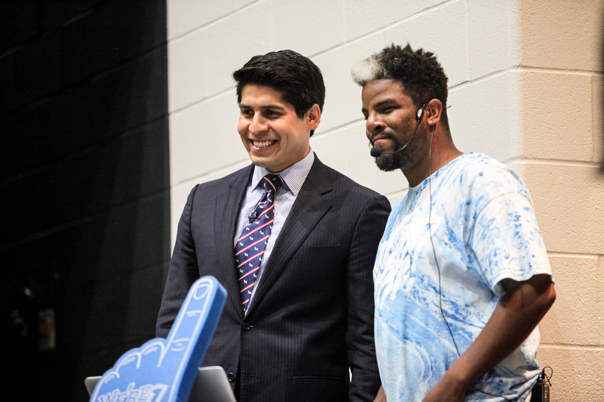 Councilman Rey Saldaña (D4) and South San Antonio High School student DJ Christian Forney celebrate at Forney's photo at the surprise graduation event.