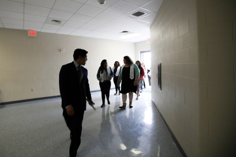 Councilman Rey Saldaña (D4) leads South San Antonio High School students down a hall to their surprise graduation celebration.