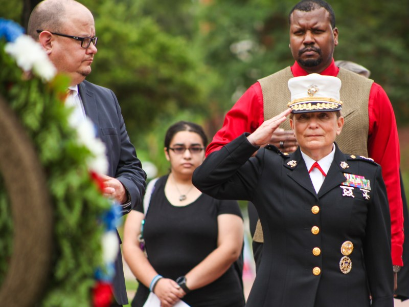Major General, U.S. Marine Corps (Ret) and CEO of Girls Scouts of America Angela Salinas salutes to the wreathe at the Memorial Day ceremony.