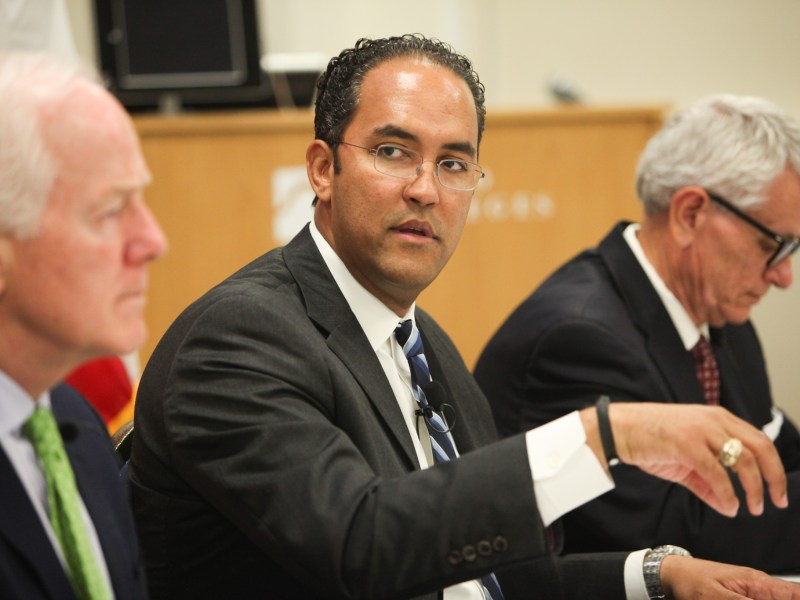 U.S. Rep. Will Hurd (R-Helotes) speaks at the panel on Texas and Mexico relations with U.S. Sen. John Cornyn (left), and Texas Transportation Commission chair Tryon Lewis (right).