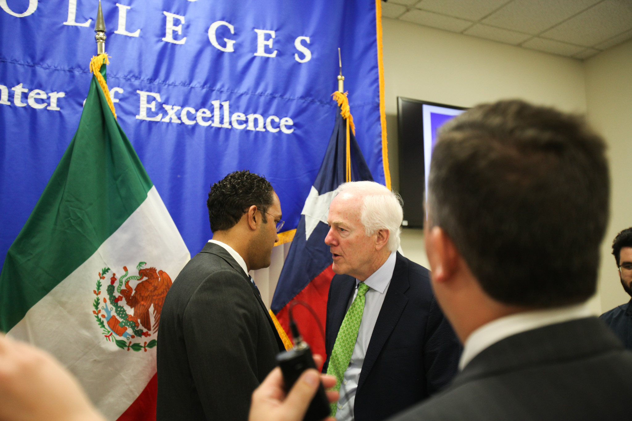 U.S. Sen. John Cornyn (left) speaks quietly with U.S. Rep. Will Hurd (D23) before the panel on Texas and Mexico relations.