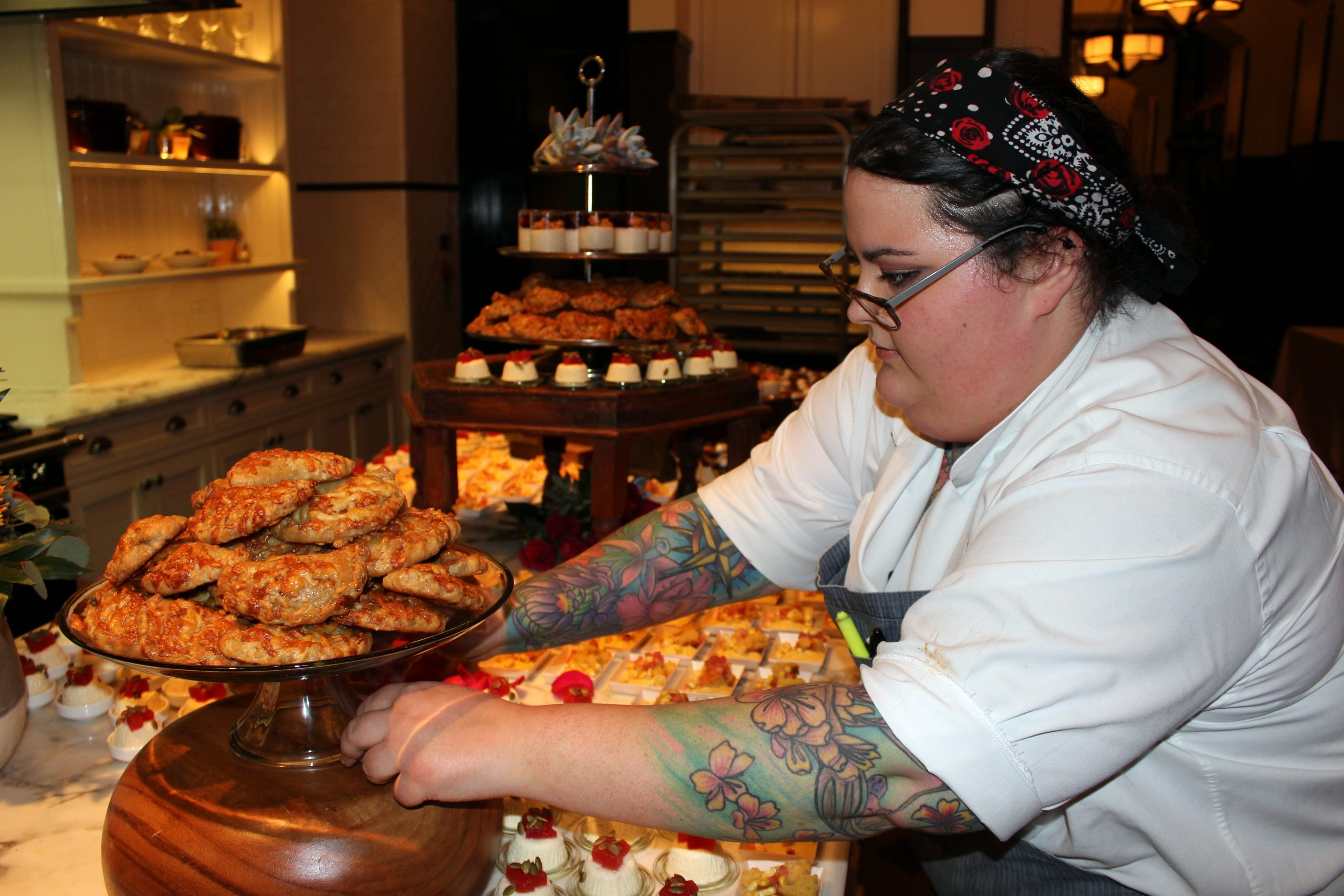 Jennifer Riesman from Hotel Emma puts the finishing touches on the dessert offerings for Ven a Comer.