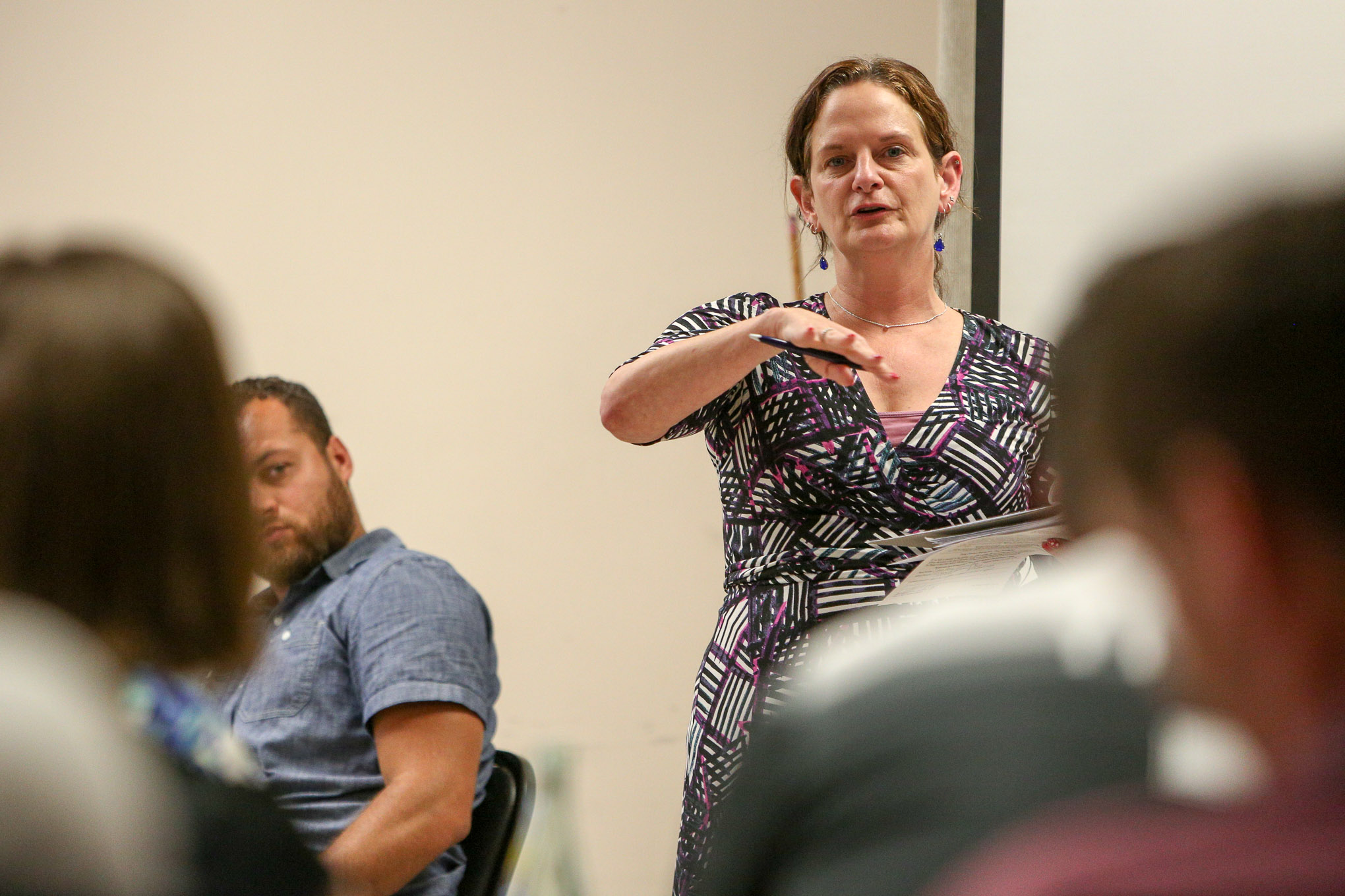 Lorena Havill told her fellow Dignowity Hill Neighborhood Association members to vote against her neighbor's request for a zoning change.