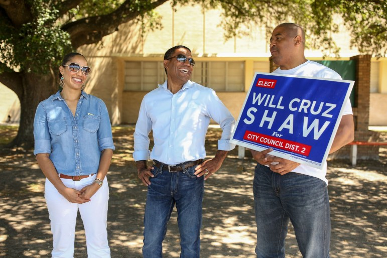 (from left) Michelle Garcia Shaw, District 2 candidate William Cruz Shaw, and Patrick Lang stand outside of Sam Houston High School waiting for voters to arrive on election day.