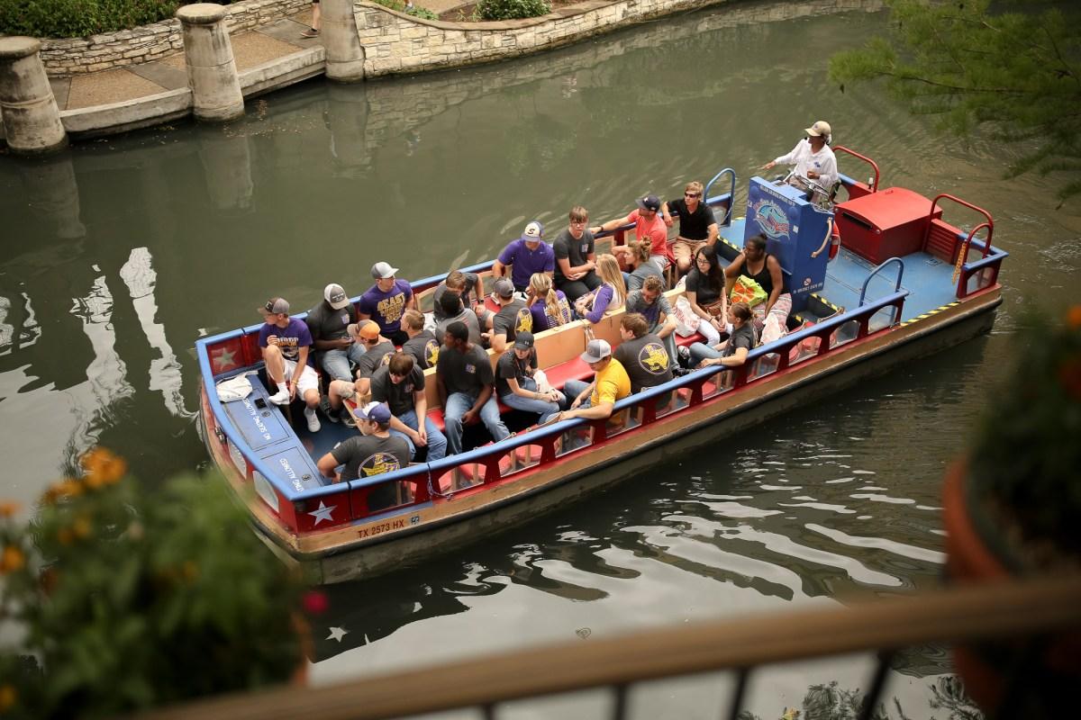 Rio San Antonio Cruises give a tour of the San Antonio Riverwalk to tourists.