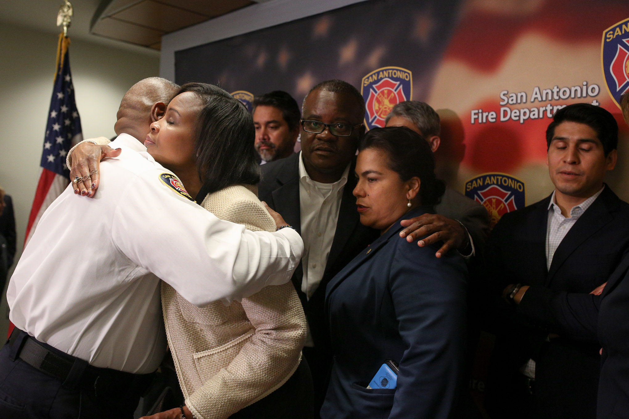 San Antonio Fire Department Chief Charles Hood embraces Mayor Ivy Taylor following a press briefing detailing the incident which killed firefighter Scott Deem of Fire Station 35.