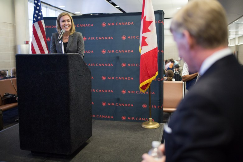 President and CEO of the San Antonio Economic Development Foundation Jenna Saucedo-Herrera gives opening remarks at the gate before her Air Canada flight to Toronto.