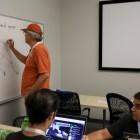 David Holland starts his team off utilizing the white board near their desk.