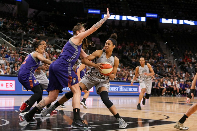 Nia Coffey works the post against the Phoenix Mercury.