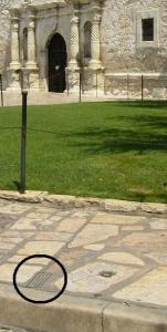Small, bronze makers indicate the original property line of the Alamo Mission.