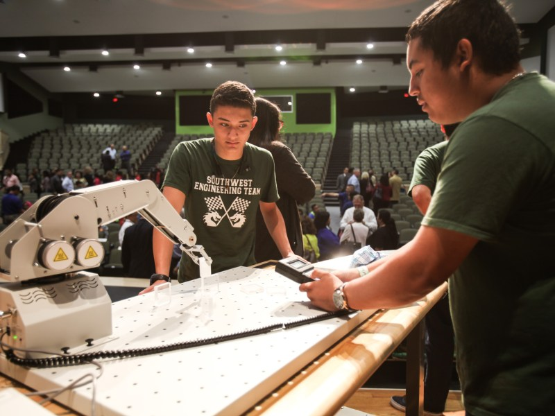 Southwest High School's Southwest Engineering Team tests a robot on stage after Southwest ISD receives a $1.7 Million Grant from Toyota USA Foundation.