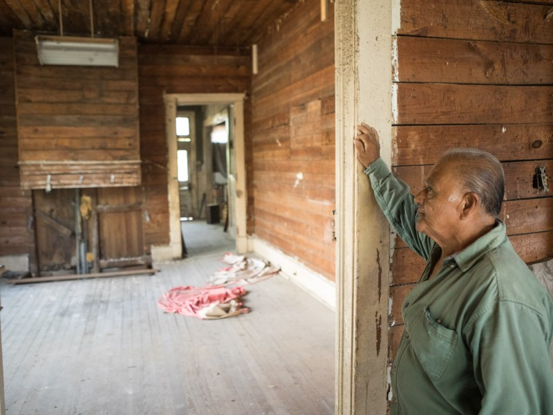 Miguel Calzada stands in the entryway to what used to be his living room.