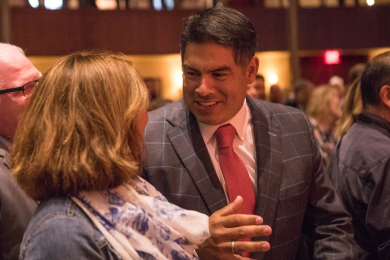 Councilman Manny Peláez (D8) chats with Councilwoman Shirley Gonzales (D5) at the reception honoring San Antonio's 2017 City Council leadership at the Pearl Stable.
