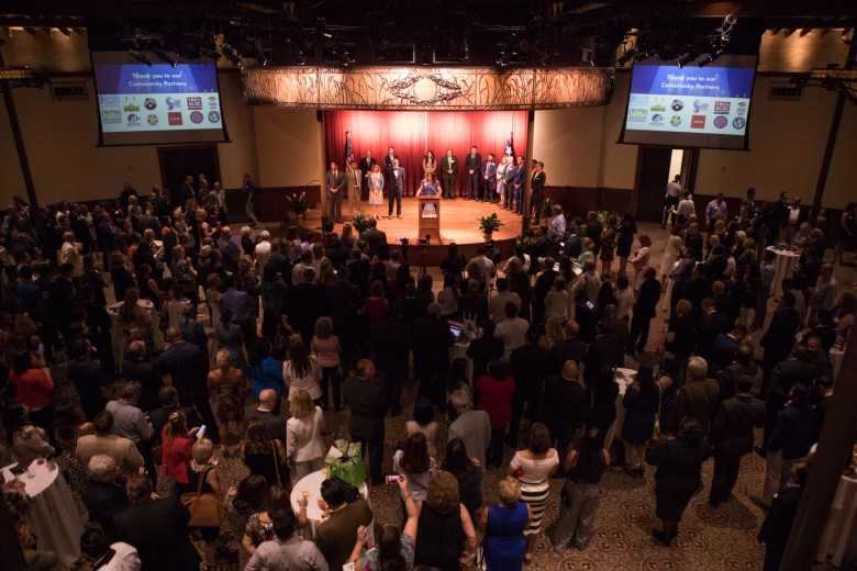 A large crowd listens to the program honoring San Antonio's 2017 City Council leadership at the Pearl Stable.