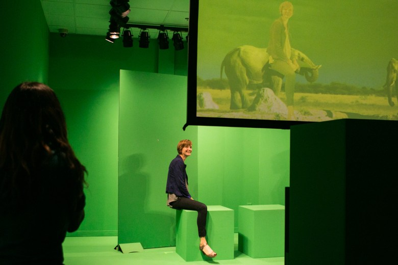 DoSeum Exhibits Director Meredith Doby demonstrates how to use the green screen in the DigiPlayspace.