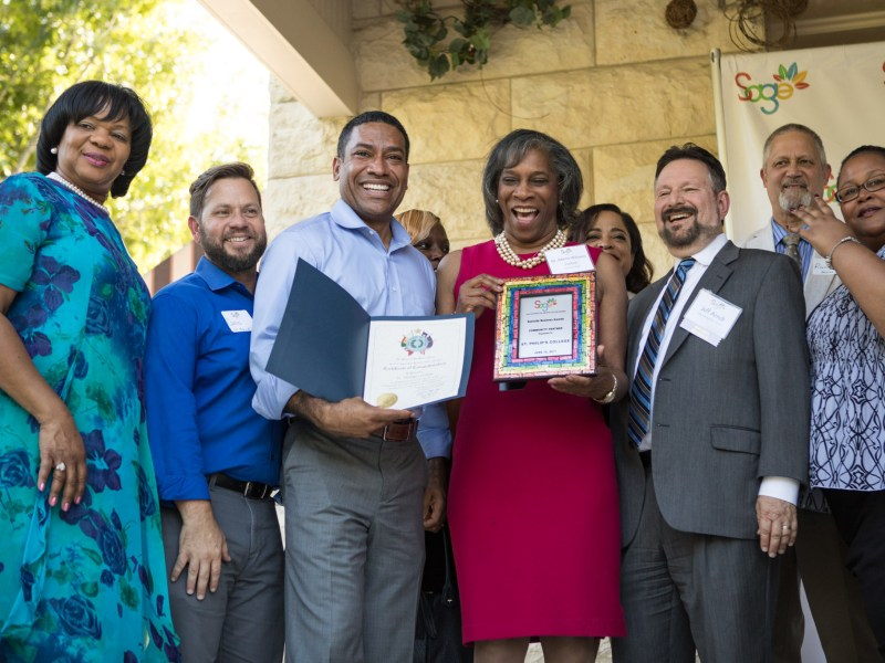 """St. Philip's College staff members accept the """"Best Community Partner"""" award at the Growth on the Eastside (SAGE) award ceremony."""
