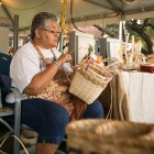 Mary O'Haver makes straw baskets at the Texas Folklife Festival.