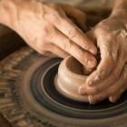 Texas Clay Festival Representative Gareth Davies makes a clay bowl at the Texas Folklife Festival.
