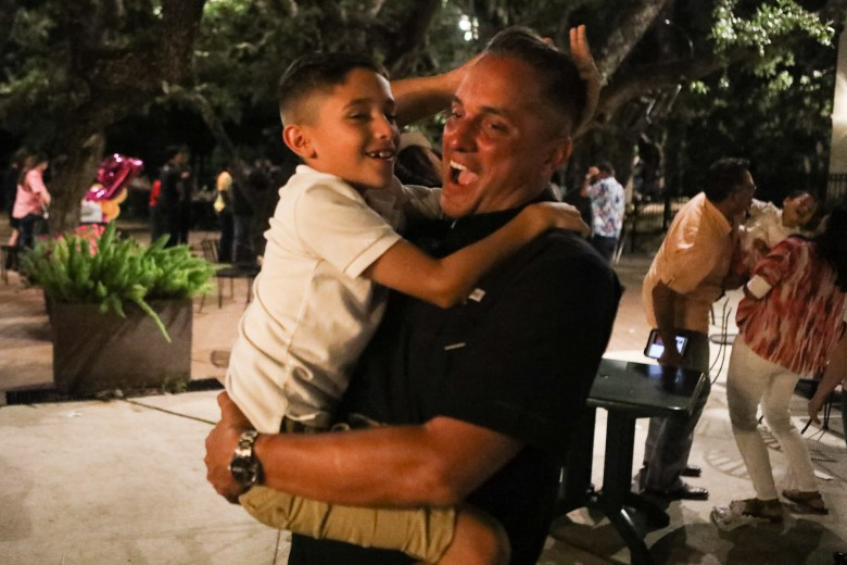 District 9 Councilman-elect Greg Brockhouse and his son Luke, 8, celebrate his victory in the runoff election on June 10.