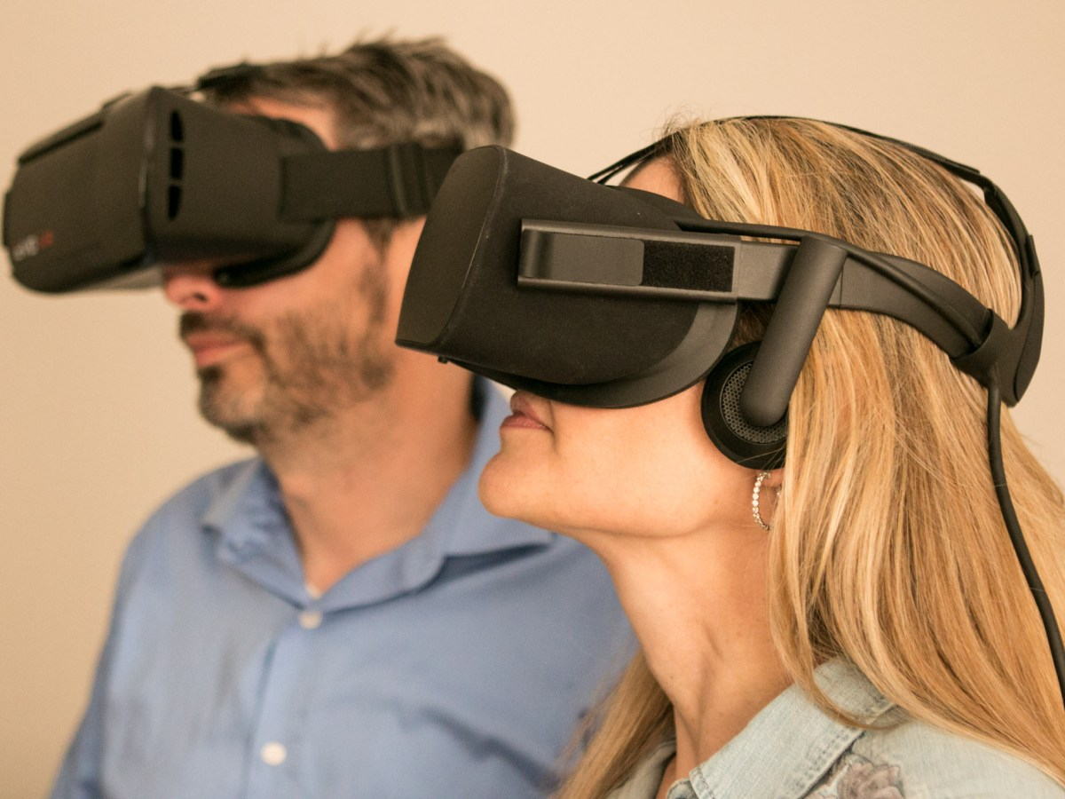 Innovative Multimedia Group President Heather Angel Chandler (right) and her husband Innovative Multimedia Group President of Interactive Media James Chandler demonstrate the Oculus Rift headsets in their studio.