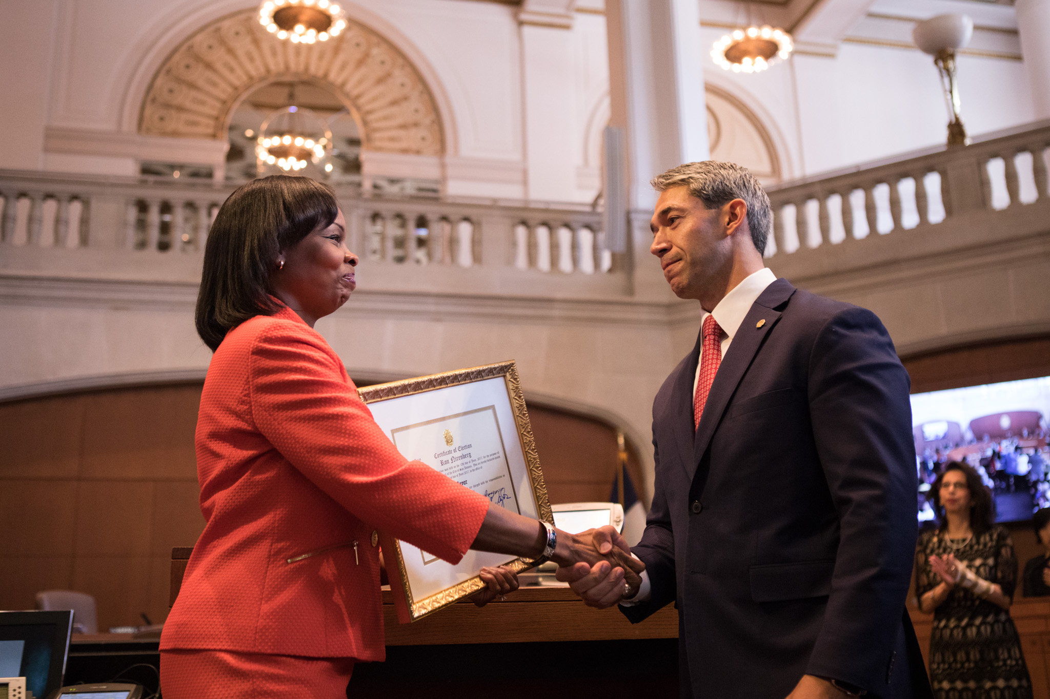 Outgoing Mayor Ivy Taylor gives Mayor-elect Ron Nirenberg the certificate of election, marking the beginning of his term in office.