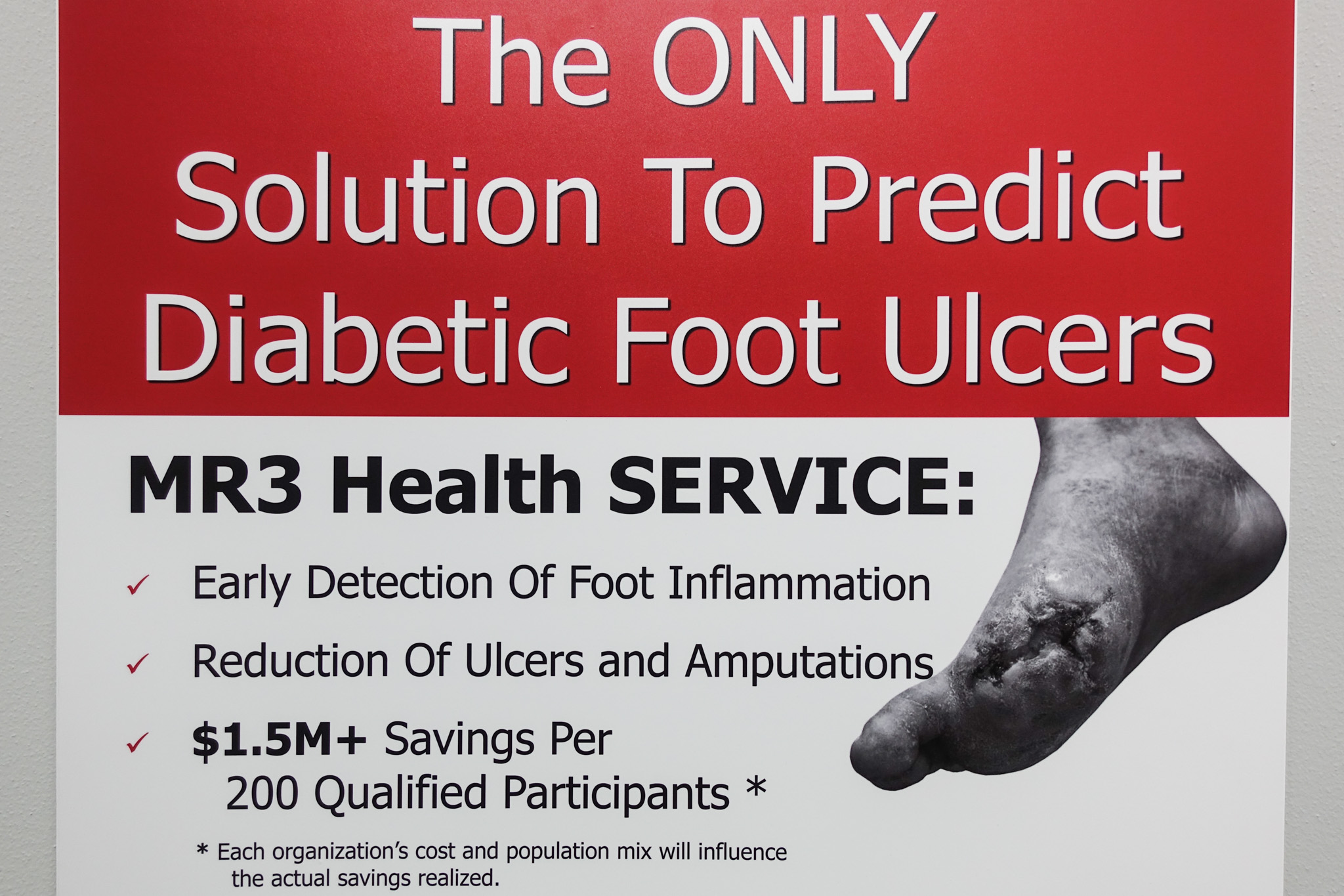 A sign advertises MR3 Health's diabetic foot sensor to predict diabetic foot ulcers in the MR3 Health office.