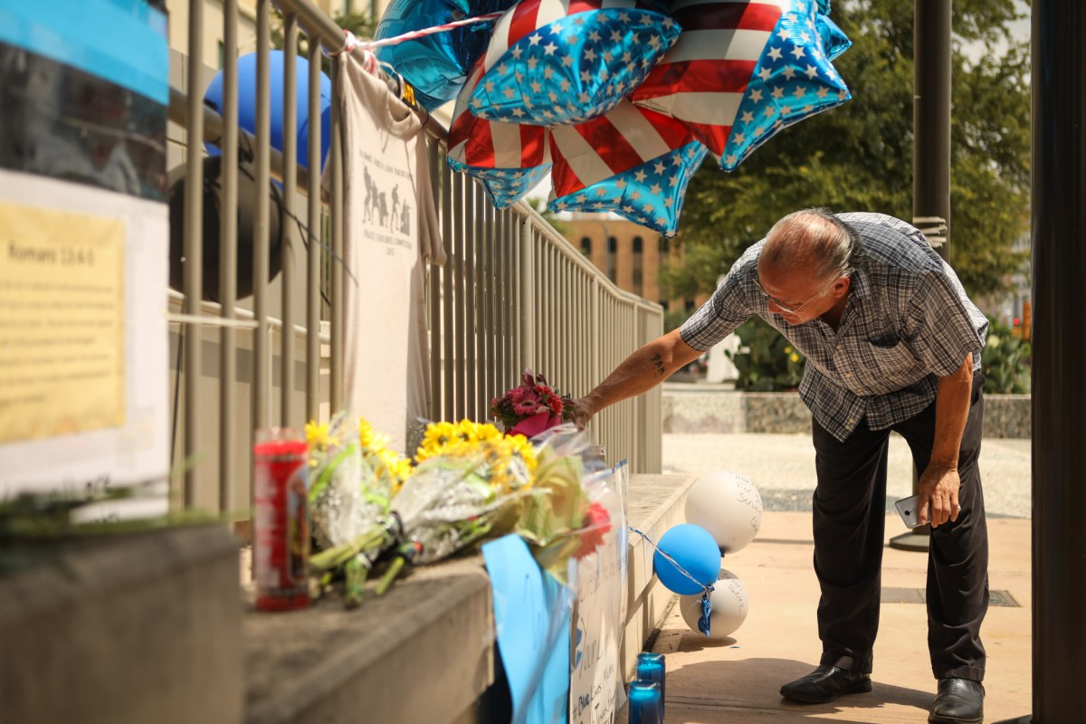 John Gomez honors of the death of Police Officer Miguel Moreno at Public Safety Headquarters.