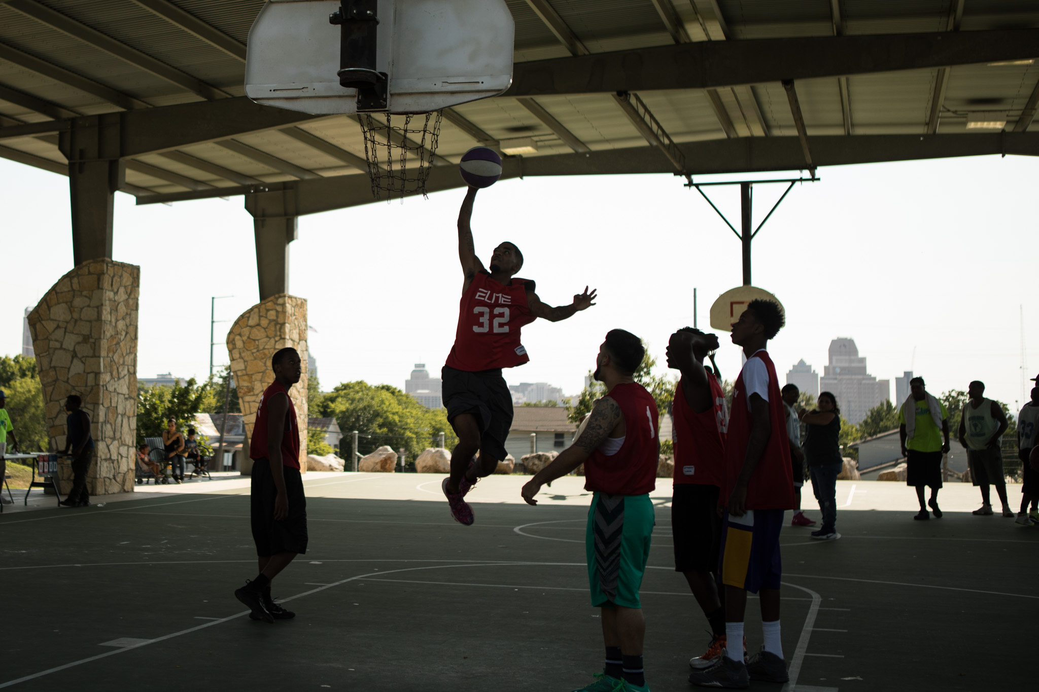 A boy dunks a basketball during the Stand Up SA peace initiative basketball tournament in Lockwood Park.