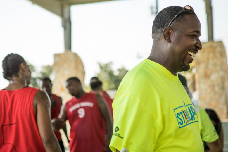 City of San Antonio Stand Up SA Coordinator Derek Taylor laughs on the sidelines of the peace initiative basketball tournament.