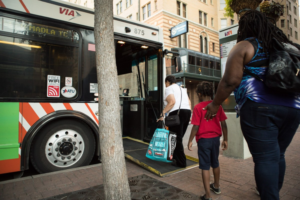 Commuters board a VIA Metropolitan Transit bus at the corner of Travis Street and St. Mary's Street.