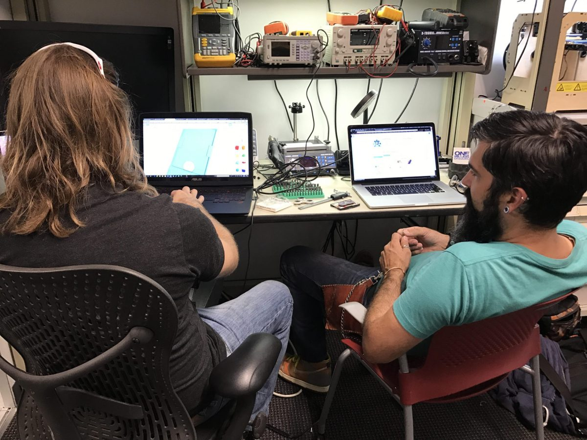 Do Lab Co-founders Drue Placette (left) and Dale Bracey test equipment in the new Geekdom space.
