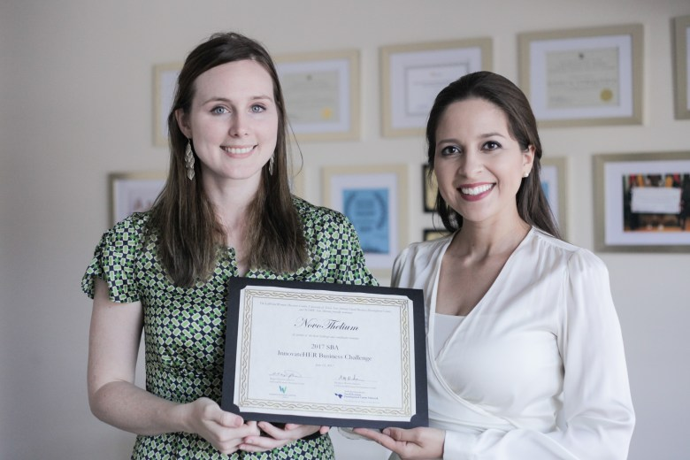 (From left) Scientists Lauren Cornell and Bianca Cerqueira hold up their most recent award for NovoThelium.