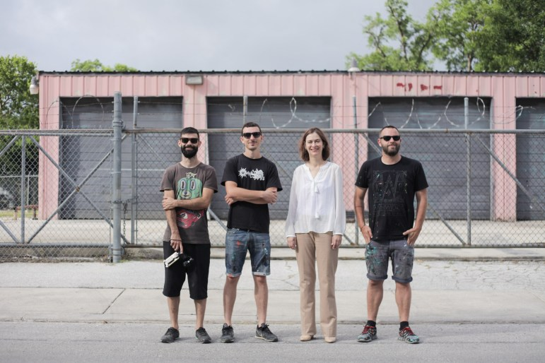 (From left) Photographer Eliott Carrera, muralist SABEK, executive director at Luminaria Kathy Armstrong, and muralist Joan Tarrago stand on Lone Star Blvd. near the location of their mural Grackle.