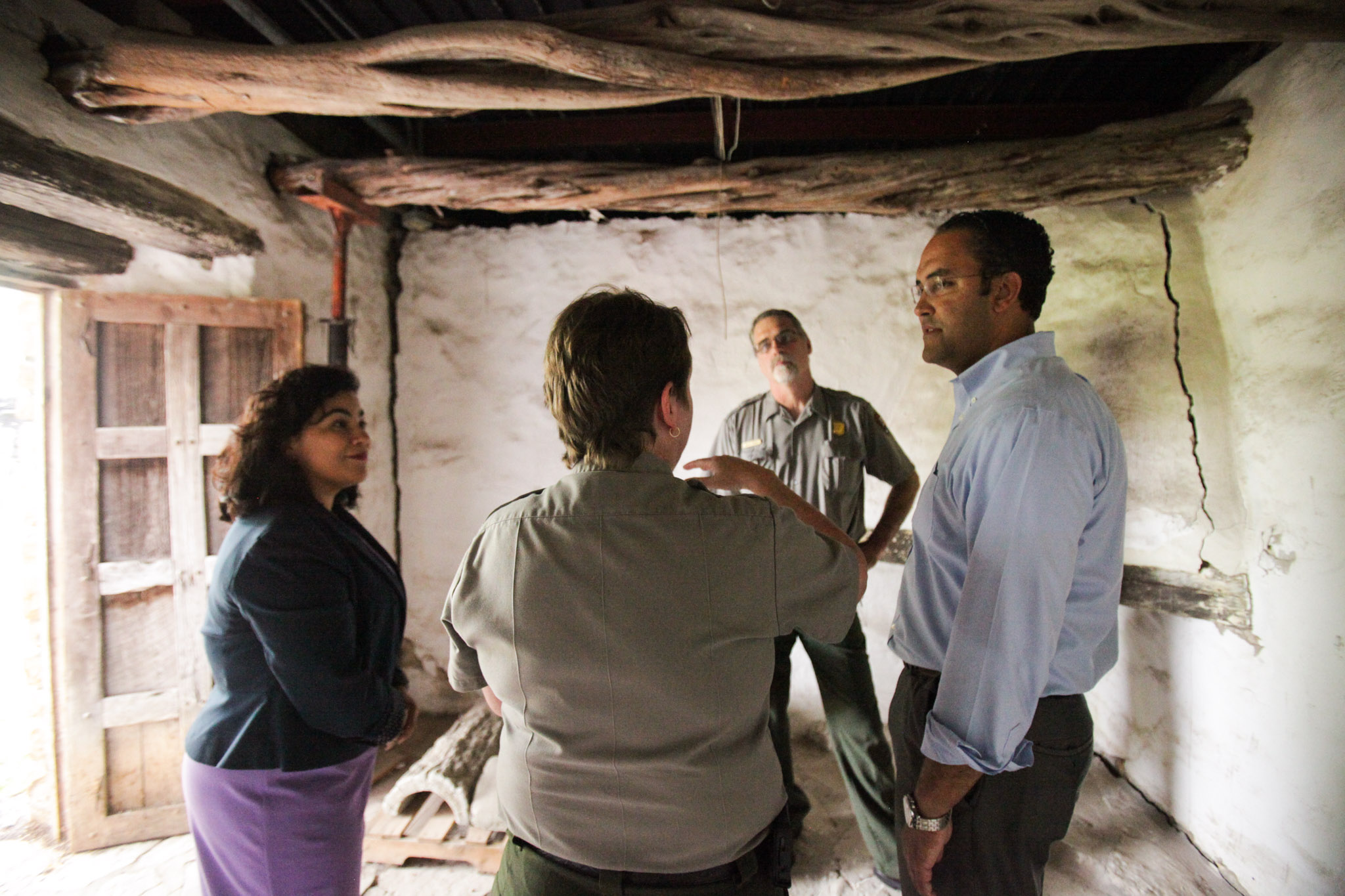 U.S. Rep. Will Hurd (right) discusses the National Park Service Legacy Act with (from left) Councilwoman Rebecca Viagran (D3) San Antonio Missions National Historical Park Superintendent Mardi Arce, and National Park facility manager David Vekasy at Mission San José.