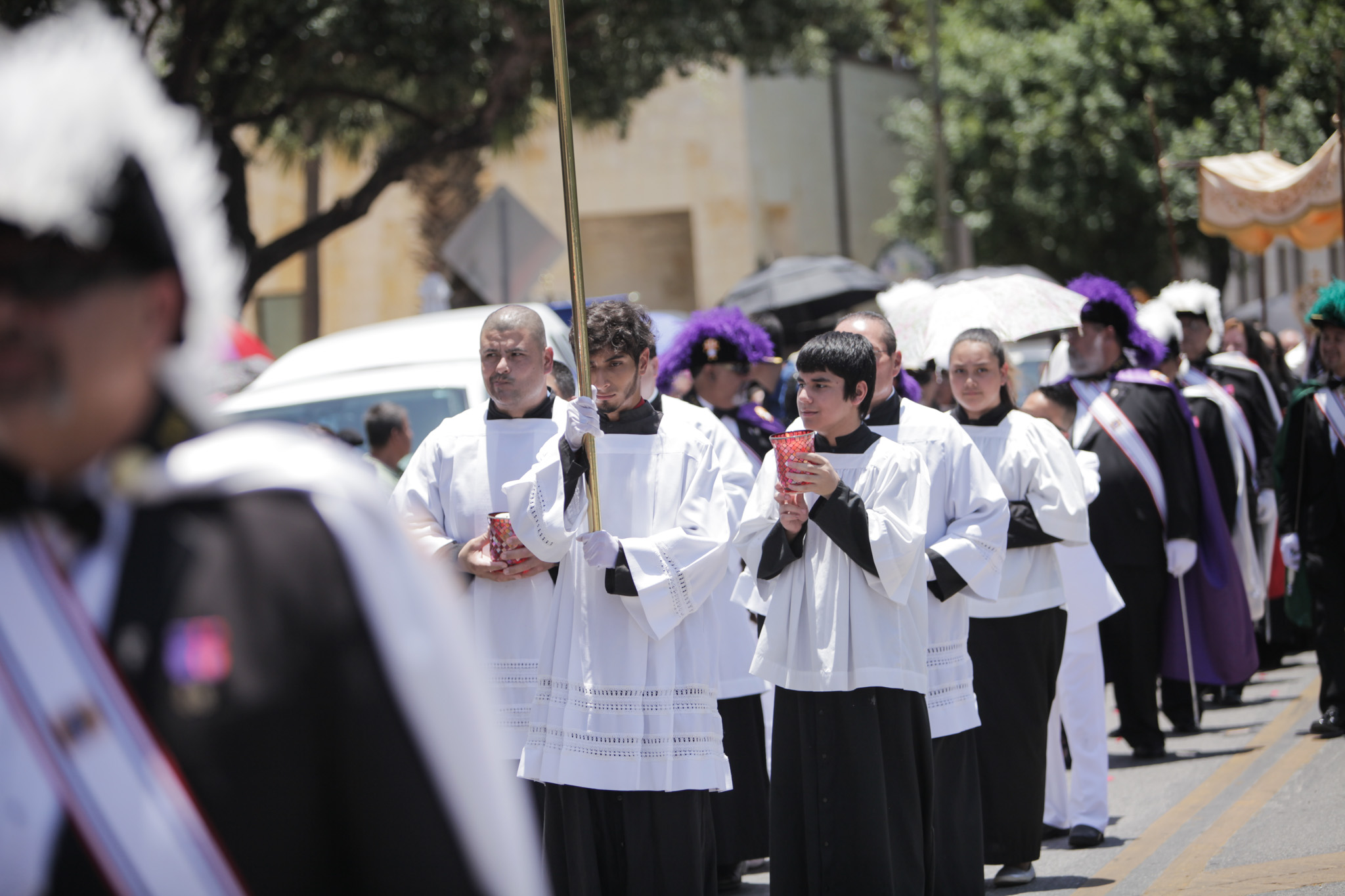 Members of the church hold candles and walk through the streets of downtown San Antonio during the Feast of Corpus Christi Procession.