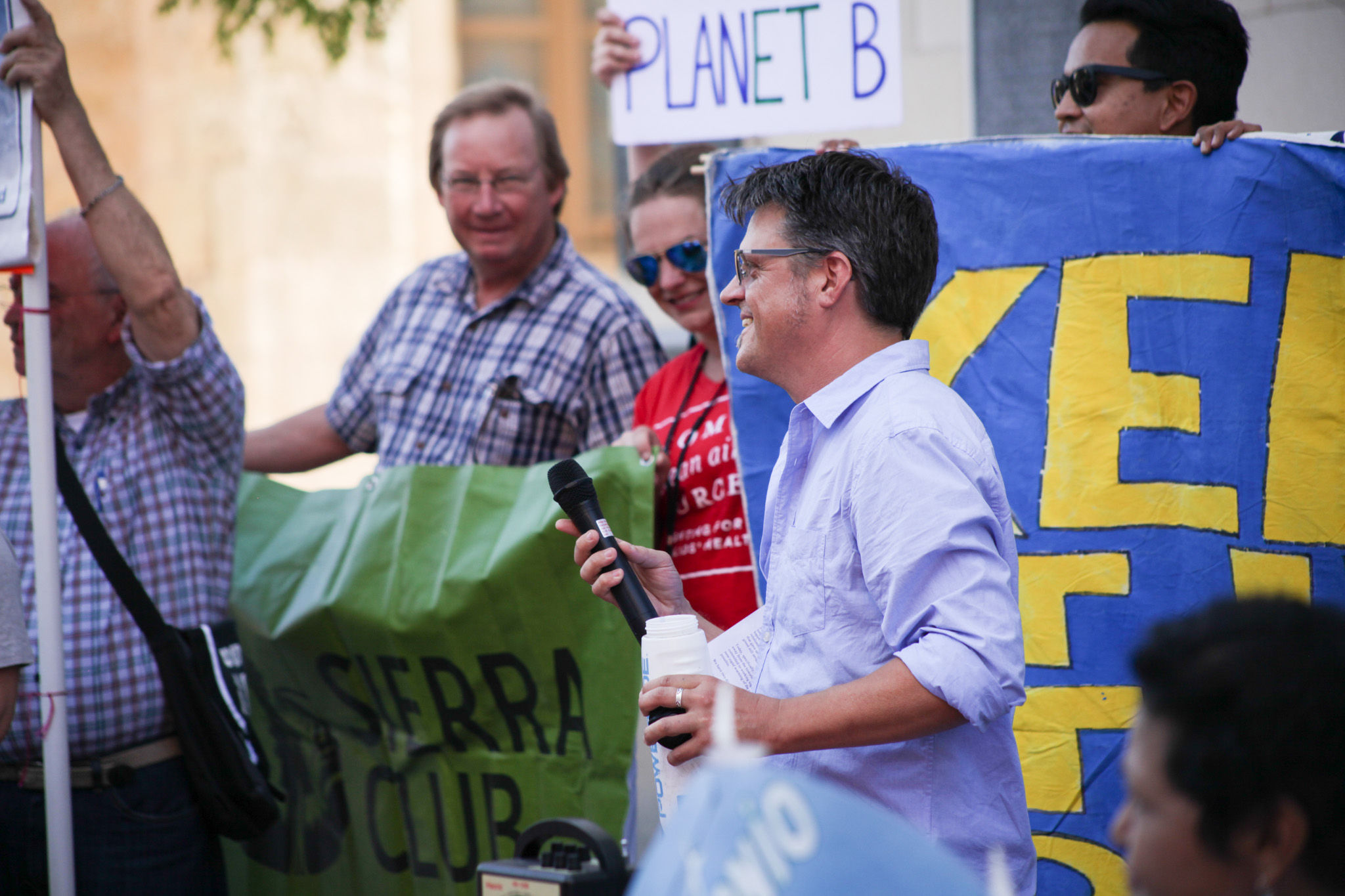 Clean energy organizer for the state chapter of the Sierra ClubGreg Harmon speaks at the rally for Paris Agreement.