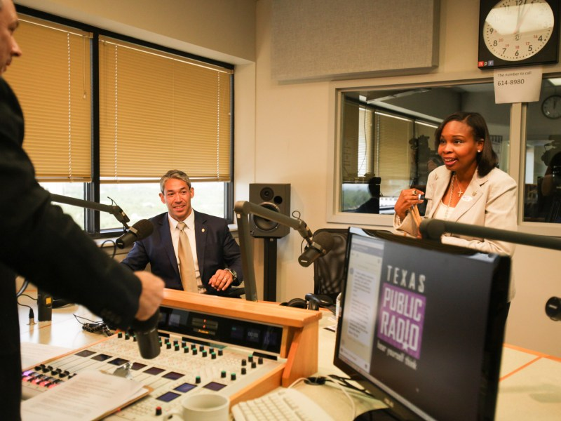 Councilman Ron Nirenberg (left) and Mayor Ivy Taylor (right) greet the radio hosts before a live debate on Texas Public Radio.