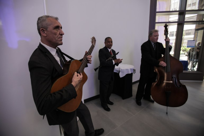 Barry Brake Trio plays at the grand opening of the BBVA branch at the Weston Centre in downtown San Antonio.