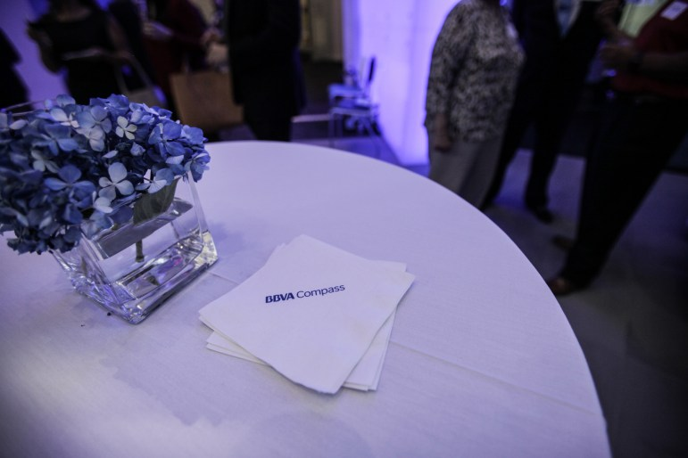BBVA Compass napkins and blue flowers act as decor at the grand opening of their new branch at the Weston Centre.