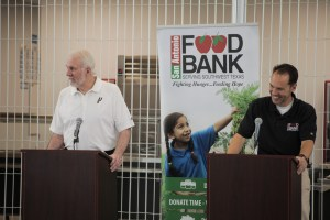 San Antonio Spurs coach Greg Popovich (left) and CEO of San Antonio Food bank Eric Cooper (right) discuss the Food Bank's urgent need for donations and volunteer work this summer.