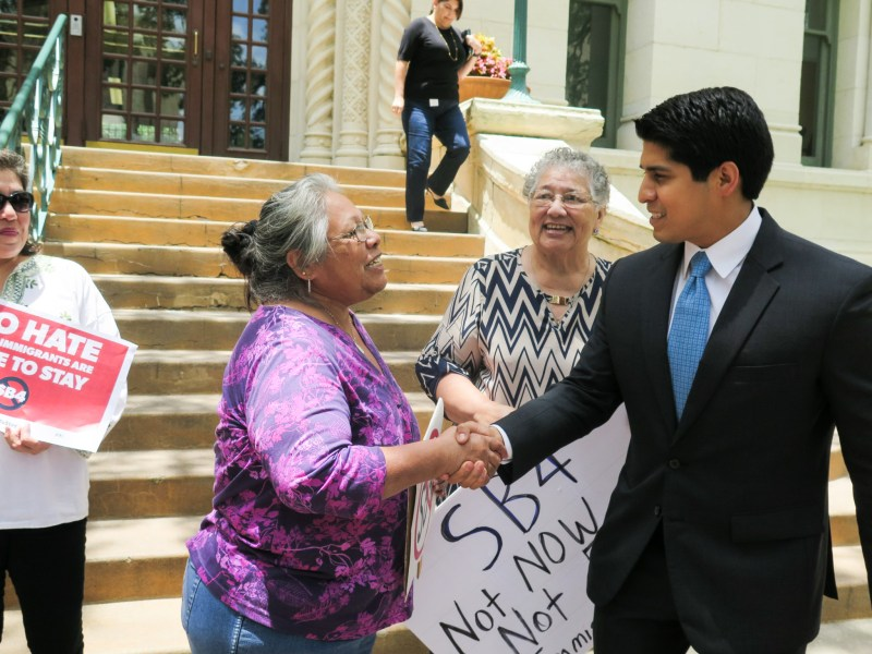 Councilman Rey Saldaña (D4) greets a supporter during a press conference in support of the City's effort to join a lawsuit with MALDEF against SB 4 in June.