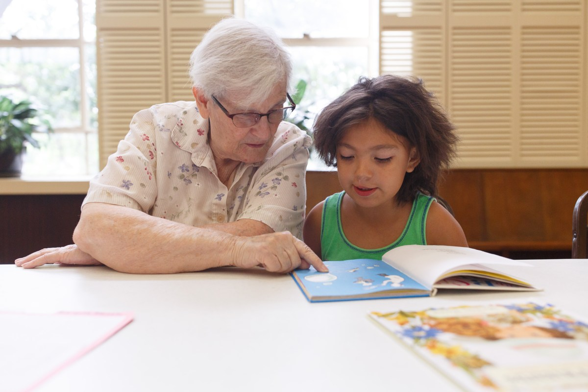 Diane Boehme reads aloud with Nevaeh, 7.