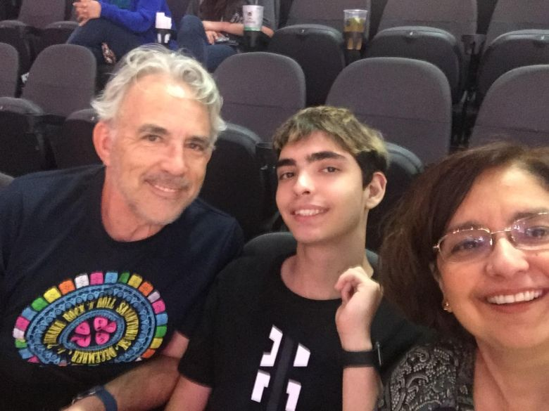 Rivard Report Director Robert Rivard with his godson Philip True Jr. and Martha True at a recent Spurs game.