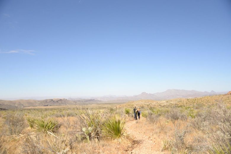 The author and her companion hike in the wild West Texas landscape.